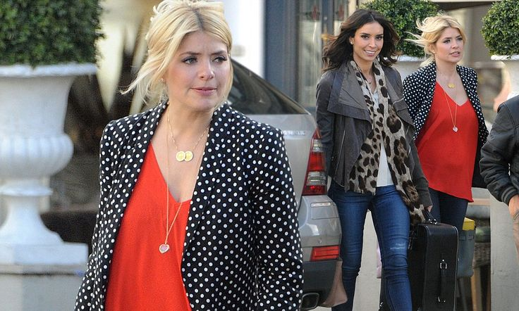 Pregnant Holly Willoughby shows the first hint of a baby bump #DailyMail