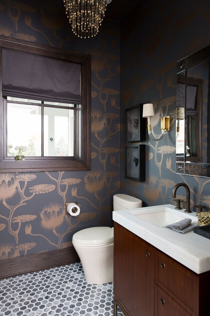 Stunning gold an black wall paper inside powder bathroom Designed by Alice Lane  Photo by Nicole Gerulat