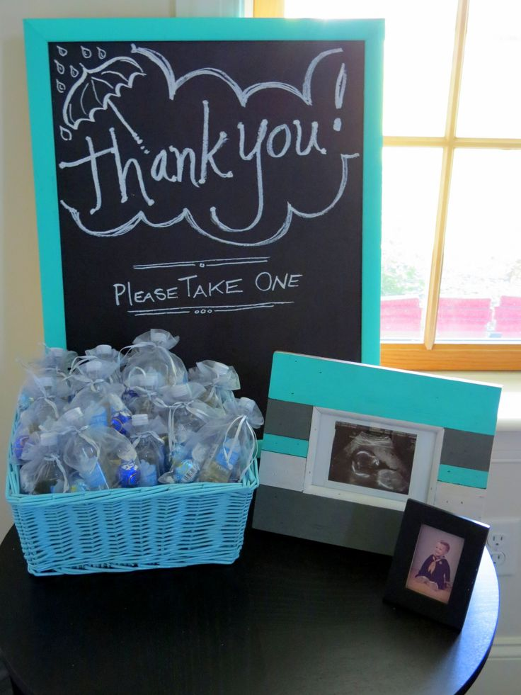 ACTUAL: Thank you sign and baby shower favors - Poppin' whipped cream vodka mini bottles and assorted chocolates wrapped in blue
