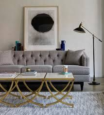 Image result for grey sofa, gold side table