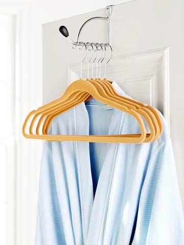 Give guests a spot to hang clothes without having to rearrange a closet. Hang an over-the-door hook and stock it with several slim hangers plus a lightweight robe.