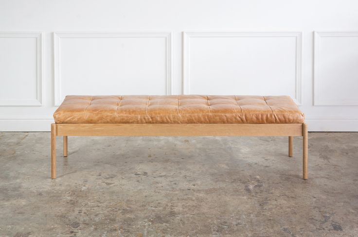 The Franc Ottoman in America oak with hand stitched leather cushion.