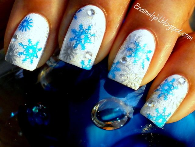 Wet n' Wild White and Color Club Snowflake as a base. Stamped with Konad Blue Pearl and China Glaze Devotion.