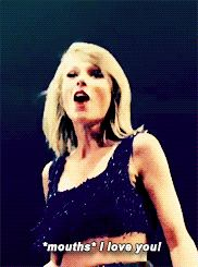"""Taylor Swift blowing a kiss and mouthing """"I love you"""" to the crowd at the 1989 tour in Bossier city."""
