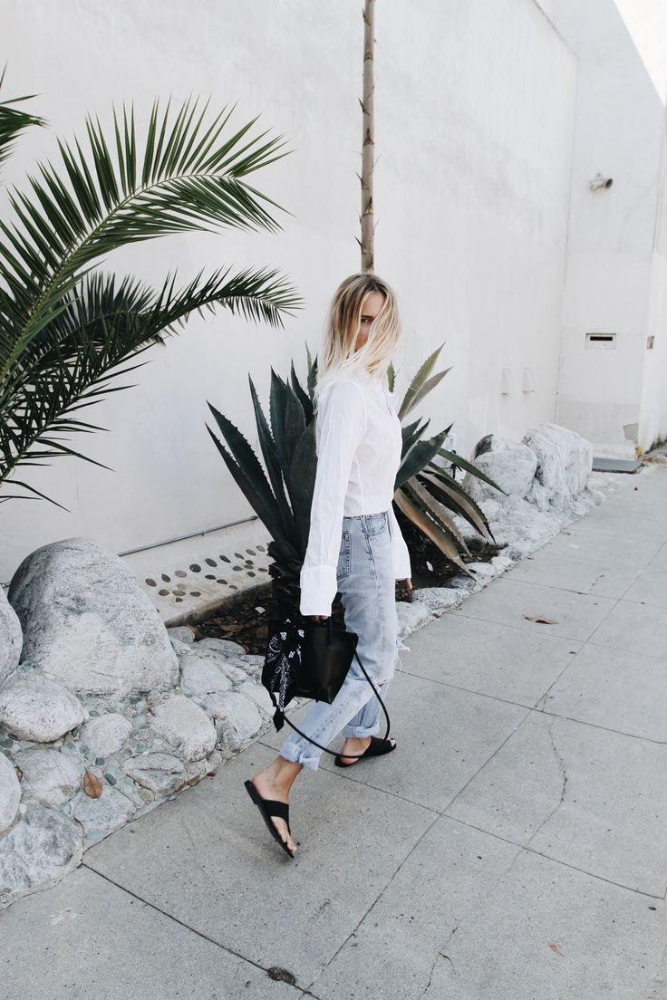 NILI LOTAN       white shirt  (similar here)  LEVIS     vintage 501 jeans (or here)  KOZHA NUMBERS      black leather bag  POPPY & CO     black bandana TONY BIANCO    leather sandals _____   _____ Late summer evenings in Venice Beach. More photos on my Pinterest.  x