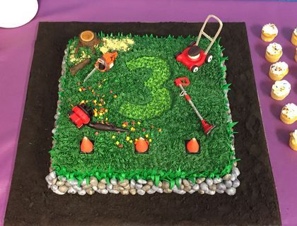 This is the cake that I made for my son's 3rd birthday.  He wanted a lawn mower/landscaper theme.  The cake is covered in buttercream frosting with fondant leaves and fondant rocks.  I made the lawn mower, chainsaw, edger, and backpack blower out of a mixture of fondant and gum paste.
