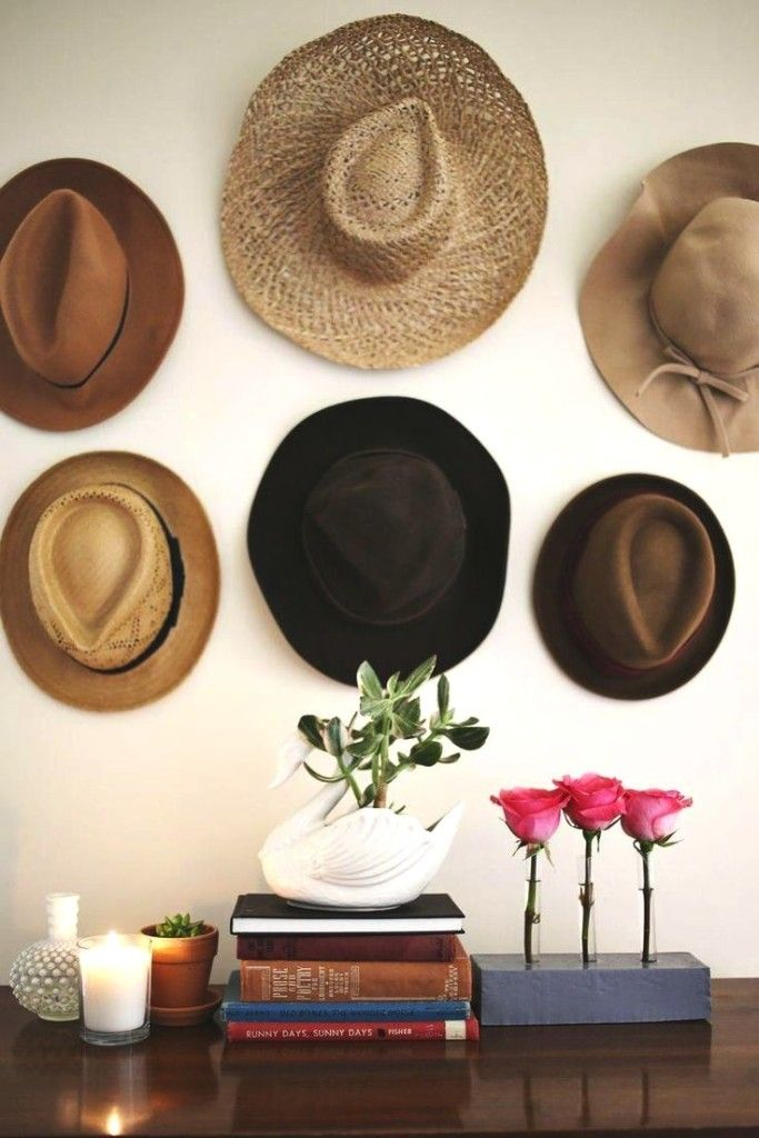 18 Hat Organizing Ideas For Summer // closet & wardrobe storage // Hats hanging like artwork in the bedroom