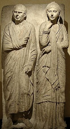 cA. 75-60 BCE. Roman Funerary relief of a freed married couple. This was a common portrayal by former slaves. At this time the ratio of slave to citizen was 1 to 3. Only after being freed did their marriage have legal status hence the portrayal has layers of meaning. The wife is idealized in the modesty pose of virtue while the man looks natural wearing the ('arm-sling' style) Toga the symbol of a roman citizen -a free man. Via Statilia, Rome. Capitoline Museums
