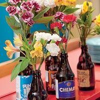 <3 flores em garrafas