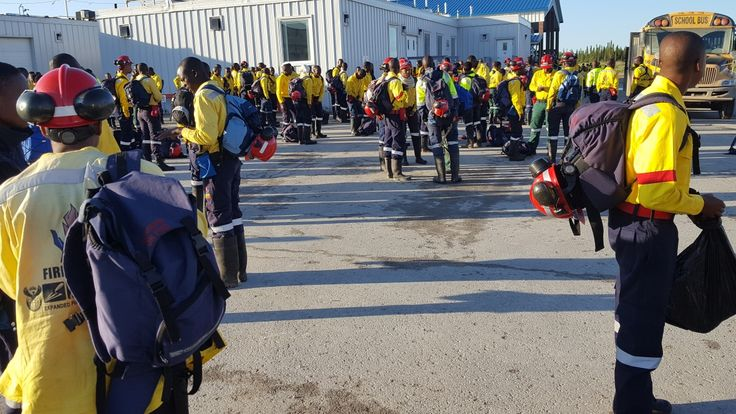 The South African firefighters who made international headlines for singing when they arrived in Canada have now turned to protests over the wages they're being paid.