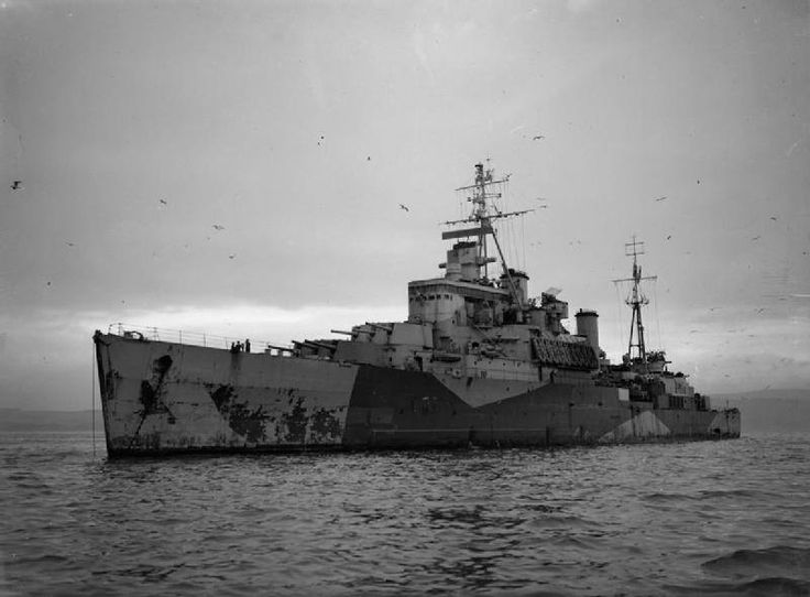 """HMS NEWFOUNDLAND"" (59) was a (555') Crown Colony Class Light Cruiser – Commissioned: 21 January Crew: 730 Officers and Enlisted – Armament: 9 x 6 Inch (152mm) Mk.XXIII Naval Guns (3 Triple Turrets) 8 x 4 Inch (102mm) Guns (4 Twin Mounts) 10 x 40mm Bofors AA Guns (5 Twin Mounts) and 2 x Catapult Launched Supermarine Walrus – Shown at Anchor at Greenock, Scotland - Sold, Peruvian Navy, 30 December 1959"