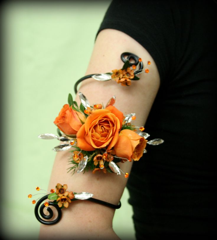 That special night deserves some Arm Candy!  These Citrus Orange Sweetheart Roses go Perfectly with Diamond Feathers & Orange Glitz.