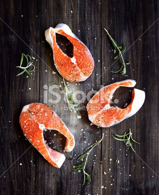 Fresh a salmon with salt herbs and rosemary Royalty Free Stock Photo