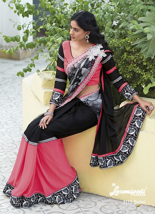 Exceptional Piece – Peach  black colored combination of this fantastic printed  embroidaried saree with matching blouse are catching everyones' eyes in the party.