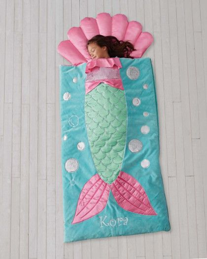 Personalized Mermaid Kids Sleeping Bag - exclusively ours - Your mermaid will enjoy a deep sleep tucked inside this. Satin and sequin appliqués dress up the luxurious plush sleeping bag with attached shell pillow. Her name (maximum 12 characters) is embroidered below the fins, and conceals a secret pocket perfect for treasures.