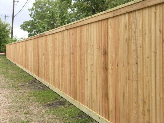 I see cedar fences for miles and miles... This is our 1x6 slats with some beauty boards on the top and bottom.