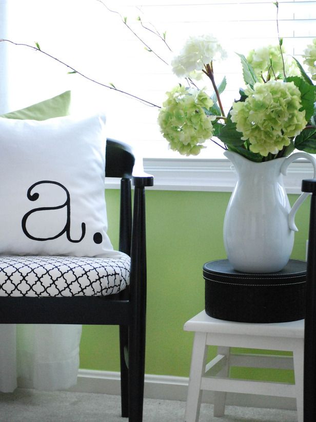 Choose a Color Scheme    The key to making an assortment of accessories work together is color. In this bedroom, the horseshoe chair is paired with a typography pillow, a simple pitcher full of hydrangeas and an elegant hatbox. A black, white and green color scheme ties the entire grouping together. Design by Rate My Spacer whitecanvas71.