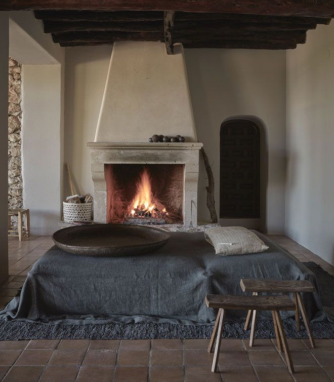 Wabi Sabi living room with antique stools near the bed. How cozy and relaxed. Get the look at MIX!