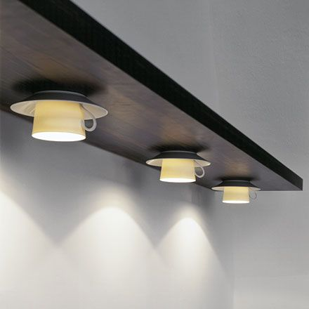 Tea cup lights from a high shelf. This brings down the ceiling, is budget friendly, charming, and practical (the wiring can be hidden out of view).