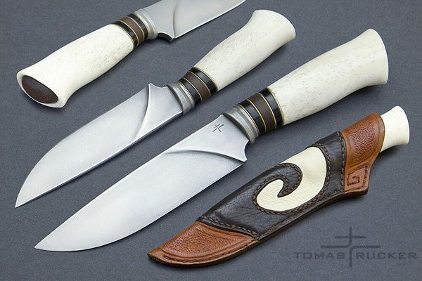 Great Tomas Rucker creates beautiful, yet functional and purposeful knives, with use of oxidation and contrasting colours along with interesting curves and design. Based in Prague, Czech Republic he uses loads of different materials to create the hilt of the knife, - Helle knives