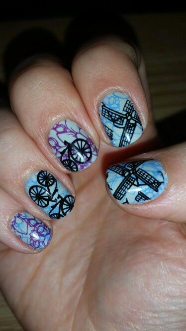 Amsterdam nails using moyou pro xl 06, cheeky European romance plate with opi skull and gloss bones and kiko and konad black for stamping