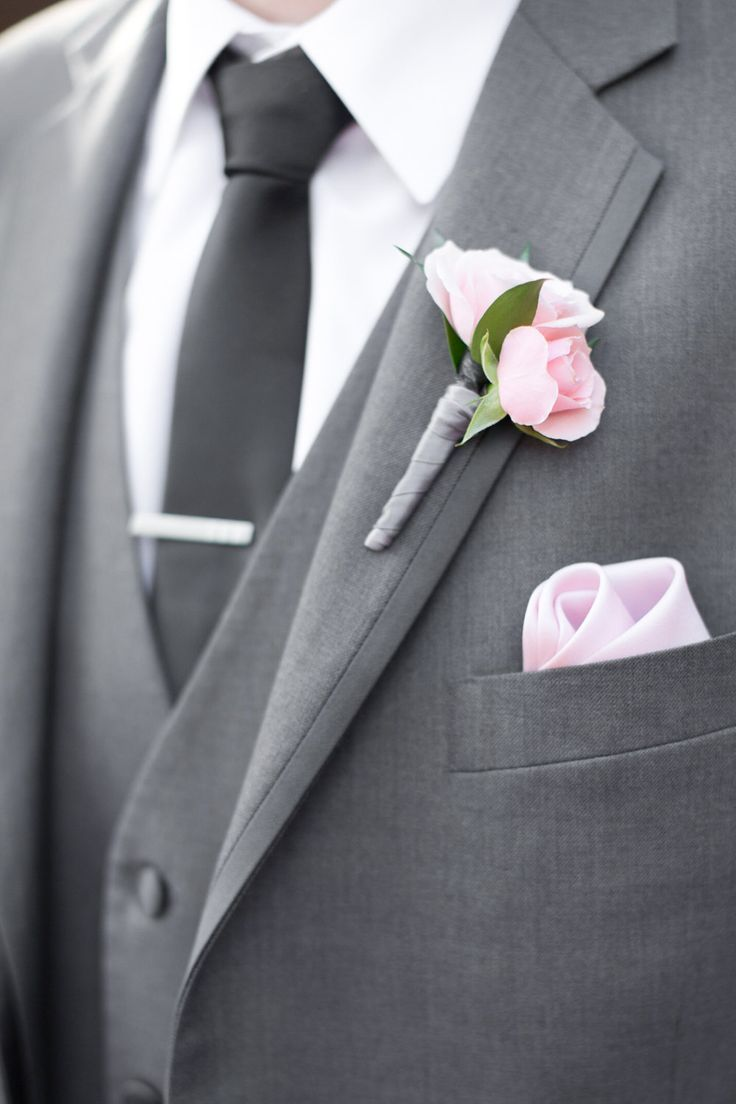 Blush pink, and navy, with grey suits for the groomsmen, and lavenders for the bridesmaids.