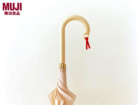 """""""A simple hole allows this umbrella to be personalised, increasing personal attachment and lowering its likelihood of becoming a 'disposable' product"""" (Konstantin Grcic for Muji)"""