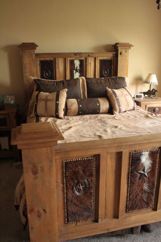 OMG this would be so cool to add cowhide to our bed like this! Adds so much character!
