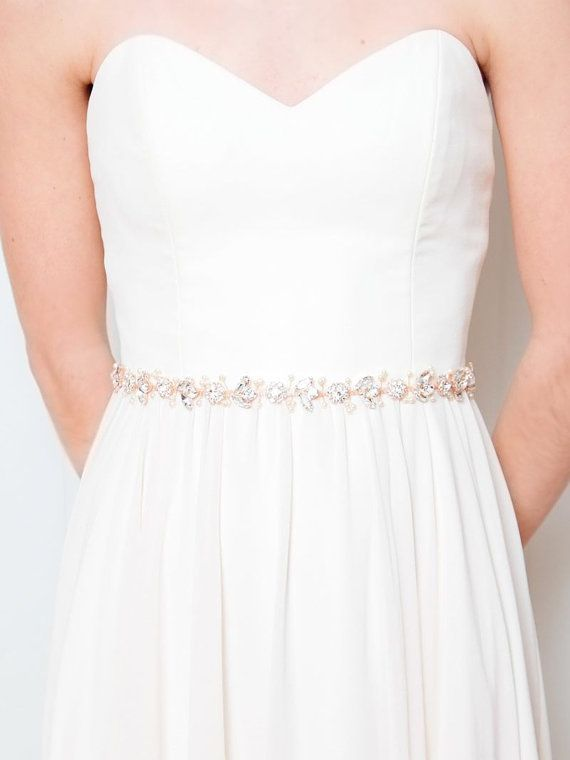 Bisoux Belt: Rose Gold A blend of dewy rhinestones, pearls and rose gold, this nature inspired bridal belt cinches the waist with subtle sparkle