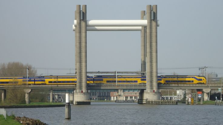 19-03-2014 © Handsein. Verlengde InteRegionale Materieel (VIRMm) passes the Gouwe spoorbrug near the city Gouda