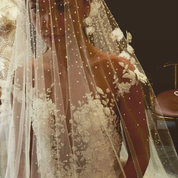 This stunning bride is wearing a jaw-dropping number of pearls.