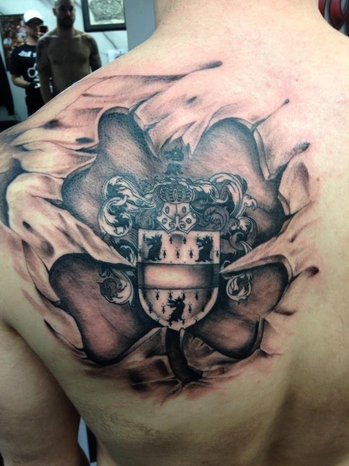 Medieval family crest skin rip tattoo on shoulder blade