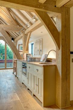 This beautiful Neptune Kitchen was designed by Distinctly Living of Dartmouth and expertly fitted into this wonderful Carpenter Oak kitchen/diner extension. Edwardian House, Dartmouth, Devon. Colin Cadle Photography, Photo Styling Jan Cadle