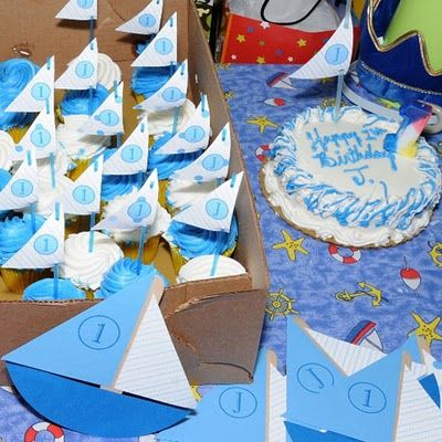 Love the sale as the topper for the cupcakes. :)    Google Image Result for http://4.bp.blogspot.com/_DwCtmQbp0MI/S2Ssx-Pmm1I/AAAAAAAACGw/Et3S4C9cIEg/s400/sailboat-party-cupcake-topp.jpg