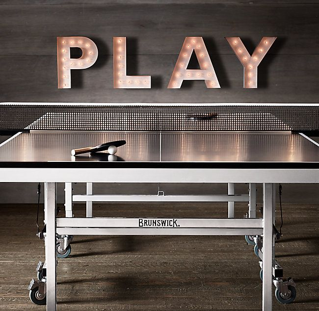 RH's Brunswick Indoor/Outdoor Tournament Table Tennis:Originally an 1880s parlor game of the British upper class, table tennis has become a game-room standard the world over. Crafted by Brunswick for indoor or outdoor use, our professional-quality table is built to endure.