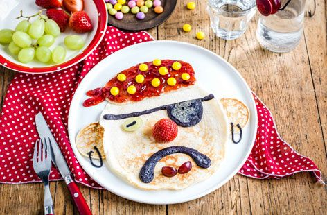 Get the kids involved with this fun and simple recipe. Strawberry jam, yellow sweets and a handful of grapes help bring this Pirate Pancake Face to life.