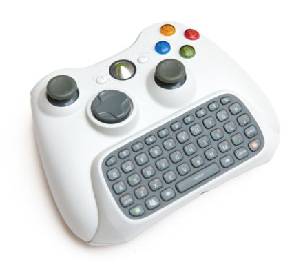 Xbox 360(a wiki list of Xbox 360 accessories) Chatpad from the Messenger Kit attached to a wireless controller