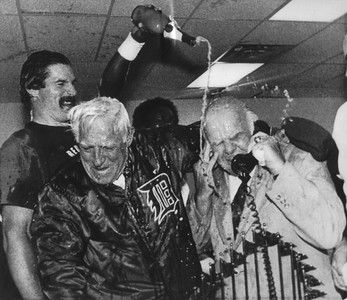 . FILE - This Oct. 14, 1984, file photo shows Detroit Tigers\' Jack Morris pouring champagne on team president Jack Campbell, right, and manager Sparky Anderson, as Campbell he takes a congratulatory phone call from President Ronald Reagan, after the Tigers defeated the San Deigo Padres to win the World Series, in Detroit. Hall of Fame manager Sparky Anderson died Thursday, Nov. 4, 2010 in Thousand Oaks, Calif. He was 76. (AP Photo/File)