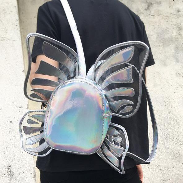 butterfly holographic backpack boogzel apparel ,  Palegrunge,  grunge, tumblrclothes, tumblrstyle, tumblroutfit, kawaiistuff,  kawaii, aesthetic, aesthetics aestheticclothes, softgrunge, softgoth, tumblrstore, grungestyle, outfitgoals, outfitidea, boogzel, boogzelapparel, kokopie boots ,unusual bag, backpack tumblr, kanken backpack