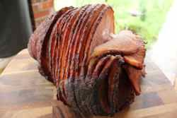 Make a Double smoked ham by taking a store bought hame that has been cured, smoked and cooked and re-smoke it to add amazing amounts of flavor to it