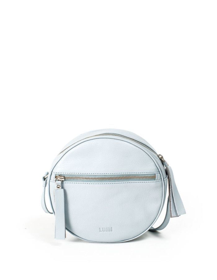 LUMI Lila Round Bag, in sky blue, is made of vegetable tanned goat leather.