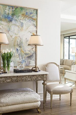 Luxe details: elaborate moulding, satin fabrics, fresh flowers and gilt accents...all make this space sing