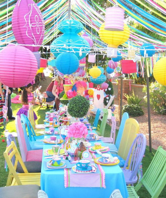 Love the idea of a ton of colourful paper decorations hanging about....with some twinkle lights and hanging teacups?!?