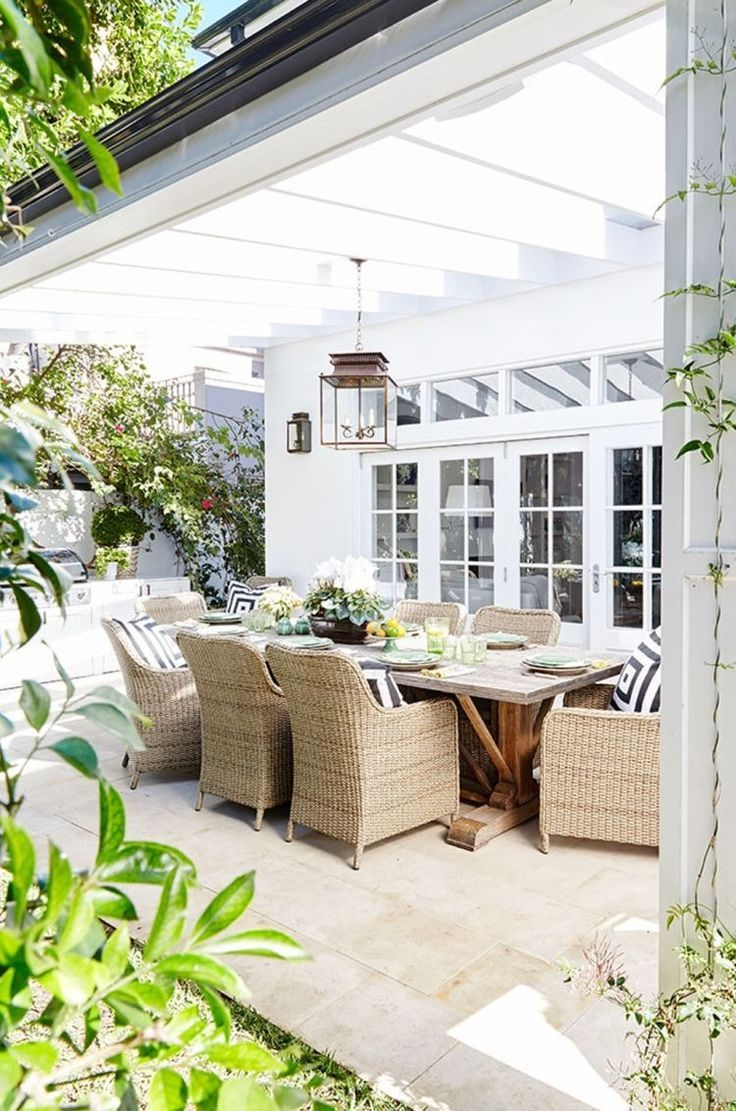 Bold black and white stripes punch up a timeless wicker dining set for a fresh look for spring and summer.