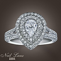 Kay Neil Lane Bridal® 1 3/4 Ct. t.w. Diamond Ring. Inspired by the allure of Hollywood's most glamorous era, Neil Lane presents a collection of dramatic bridal jewelry designs. This magnificent pear-shaped diamond is framed by twin rows of round diamonds. Additional lines of round diamonds on either side reach up to touch the center. Styled in 14K white gold with one and three-quarter carats of diamonds and Neil Lane's signature on the inside of the band. Each Neil Lane ring is hand-crafted…