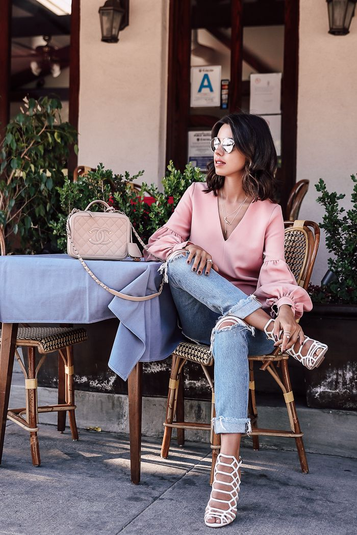 Casual pastel outfit - pink balloon sleeve top + girlfriend jeans + caged white sandals + Chanel vanity case bag