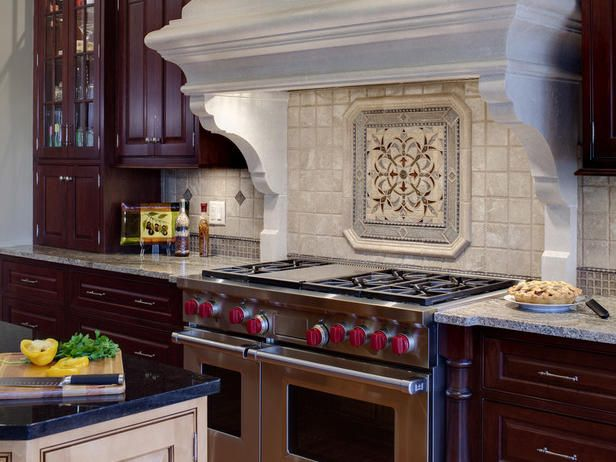 A backsplash can often be the focal point of a kitchen. Designer Gail Drury had this in mind when she designed this intricate tile backsplash framed by the stone hood.