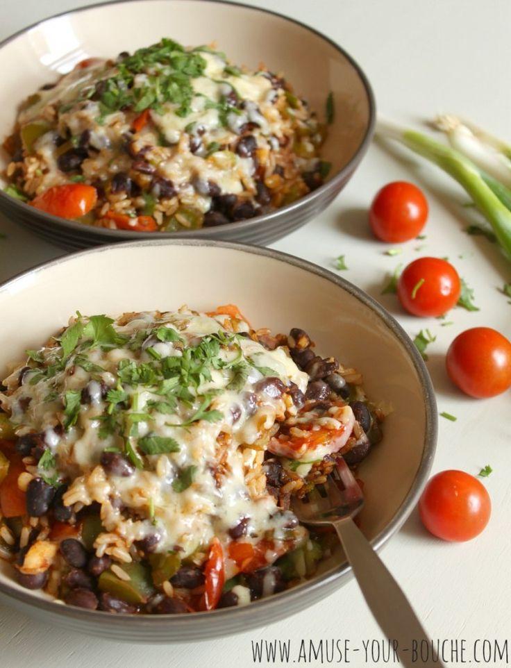 Veggie burrito bowls w. brown rice, black beans, bell pepper, cherry tomato, spring onions, cheddar, coriander.