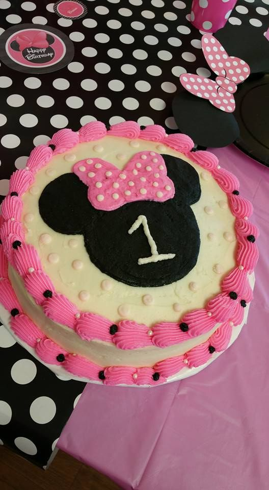 Minnie Mouse smash cake I made for grandbaby's 1st birthday. I used a print out silhouette head image and added a bow, traced around it on the cake. Filled in with black and pink icing, smoothed by dusting fingers in powered sugar (no need for fondant!) added dots and #1. Decorated edges and added dots on the top!