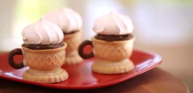 """Edible Tea Cups Topped with meringue.  Great DIY decorative dessert for a tea or garden party """"by Kin Parents""""."""